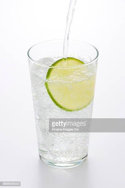 lime in sparkling water - carbonated water stock pictures, royalty-free photos & images