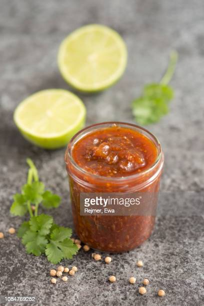 lime, mango, chilli and coriander chutney in a glass jar - chutney stock pictures, royalty-free photos & images