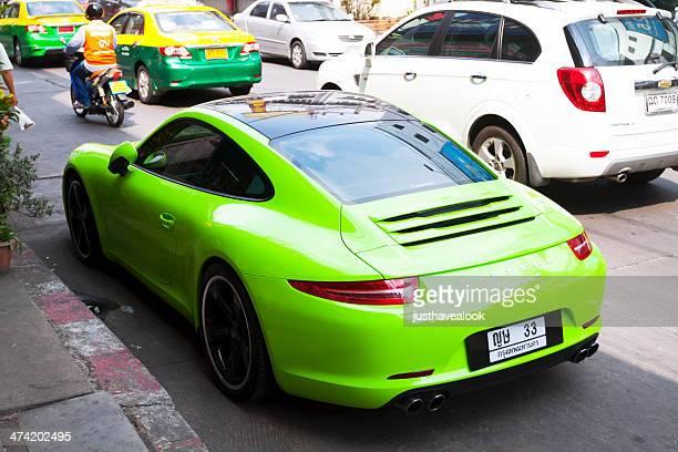 lime porsche carrera 911 s - asia carrera stock photos and pictures