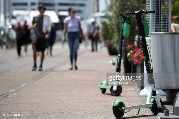 Lime scooters wait for customers at Auckland's Wynyard Wharf on November 28 2018 in Auckland New Zealand There have been almost 300 public insurance...