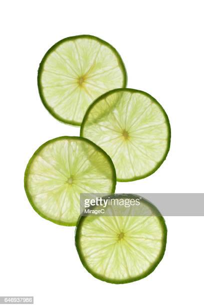 Lime Slices Stacking on White Background