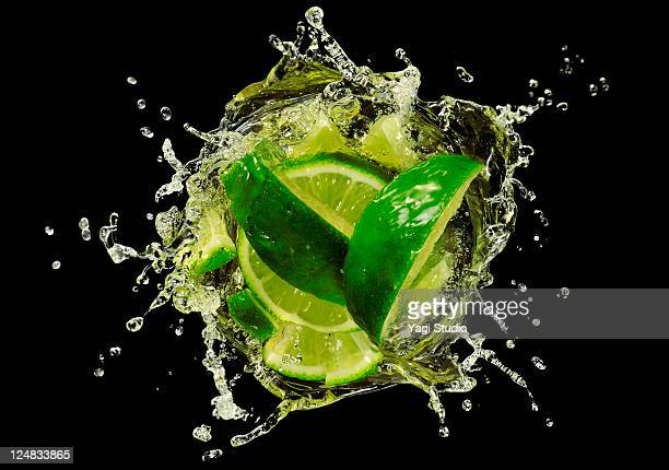 Lime  splashing into Cocktail, close-up.