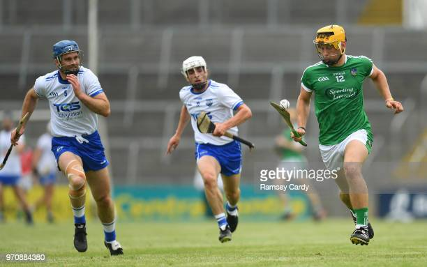 Limerick Ireland 10 June 2018 Tom Morrisse of Limerick in action against Michael Walsh and Stephen Roche of Waterford during the Munster GAA Hurling...