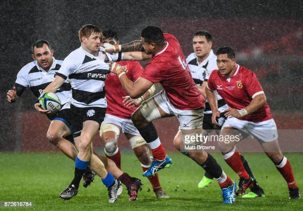 Limerick Ireland 10 November 2017 Nic Stirzaker of Barbarians RFC is tackled by Leva Fifita of Tonga during the Representative Match between...