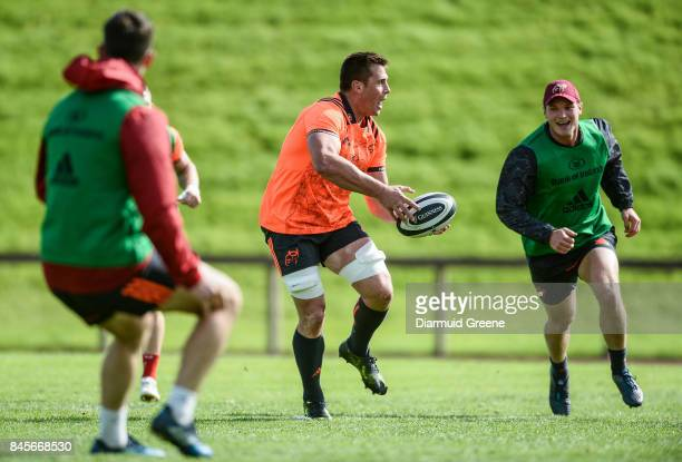 Limerick Ireland 11 September 2017 CJ Stander of Munster gets away from Tyler Bleyendaal during Munster Rugby squad training at the University of...