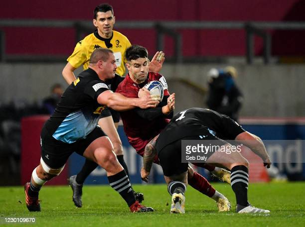 Limerick , Ireland - 13 December 2020; Conor Murray of Munster is tackled by Wilco Louw, left, and Joe Marler of Harlequins during the Heineken...
