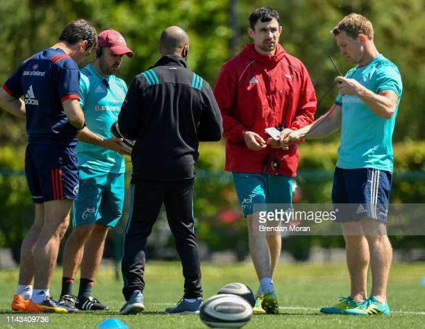 Limerick Ireland 13 May 2019 The Munster coaching staff from left head coach Johann van Graan defence coach JP Ferreira head of athletic performance...