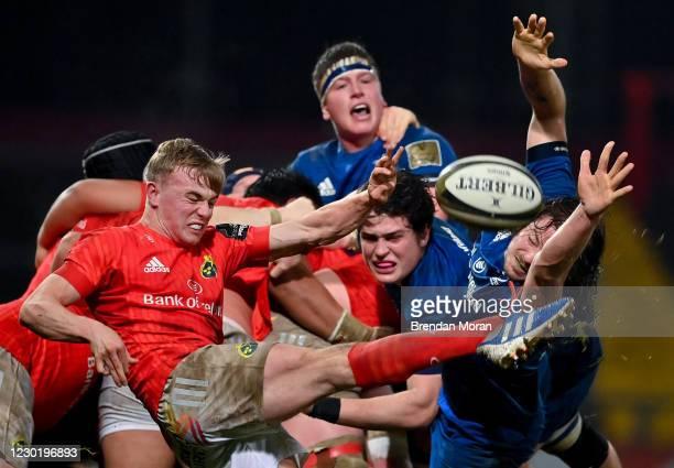 Limerick , Ireland - 18 December 2020; Ben Murphy of Munster kicks under pressure from Alex Soroka and Jack Dunne of Leinster during the A...