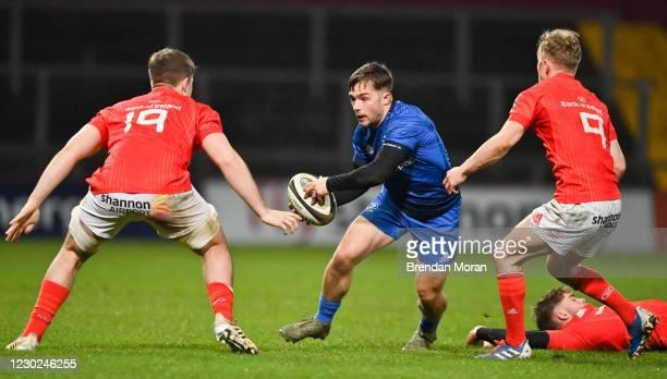 Limerick , Ireland - 18 December 2020; Rowan Osborne of Leinster in action against Alex Kendellen and Ben Murphy of Munster uring the A...