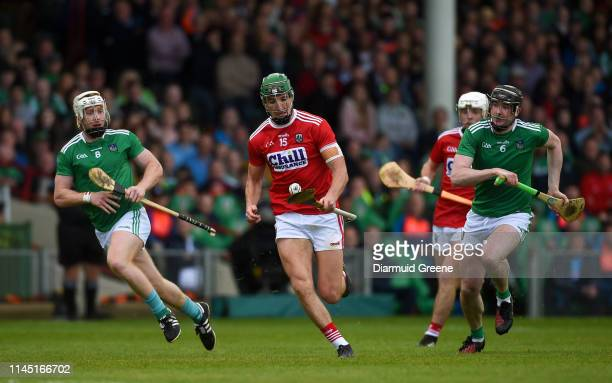 Limerick Ireland 19 May 2019 Aidan Walsh of Cork in action against Cian Lynch left and Declan Hannon of Limerick during the Munster GAA Hurling...