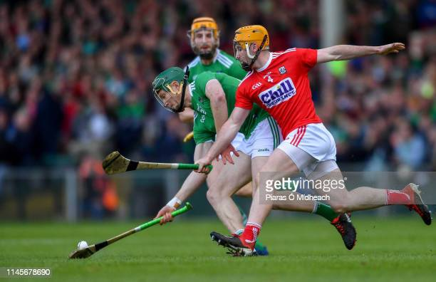 Limerick Ireland 19 May 2019 William O'Donoghue of Limerick in action against Niall O'Leary of Cork during the Munster GAA Hurling Senior...