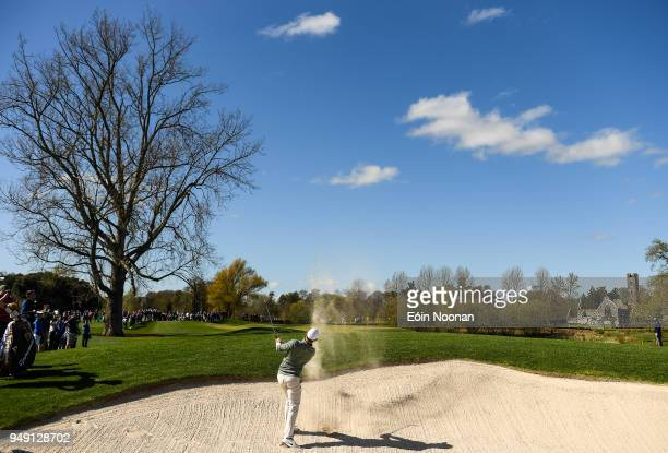 Limerick Ireland 20 April 2018 Rory McIlroy of Northern Ireland takes his second shot from the bunker on the thirteenth hole during the JP McManus...
