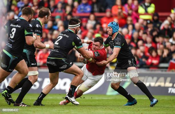 Limerick Ireland 20 May 2017 Dave Kilcoyne of Munster is tackled by Scott Baldwin left and Justin Tipuric of Ospreys during the Guinness PRO12...