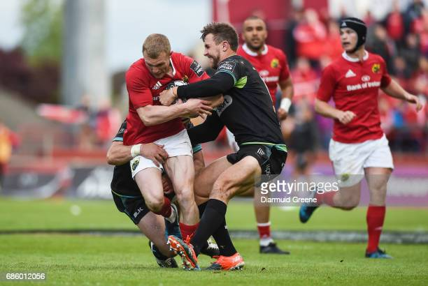 Limerick Ireland 20 May 2017 Keith Earls of Munster is tackled by Scott Baldwin left and Ashley Beck of Ospreys during the Guinness PRO12 semifinal...