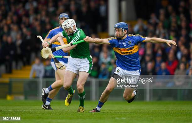 Limerick Ireland 20 May 2018 Seamus Hickey of Limerick in action against John McGrath of Tipperary during the Munster GAA Hurling Senior Championship...