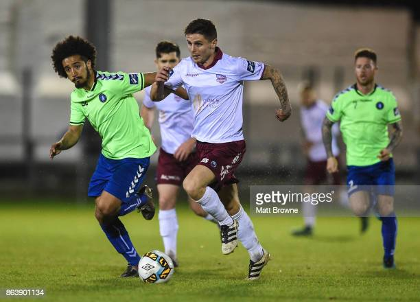 Limerick Ireland 20 October 2017 Gavan Holohan of Galway United in action against Bastien Hery of Limerick FC during the SSE Airtricity League...