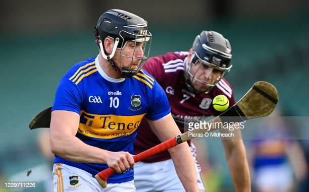 Limerick , Ireland - 21 November 2020; Dan McCormack of Tipperary in action against Joseph Cooney of Galway during the GAA Hurling All-Ireland Senior...