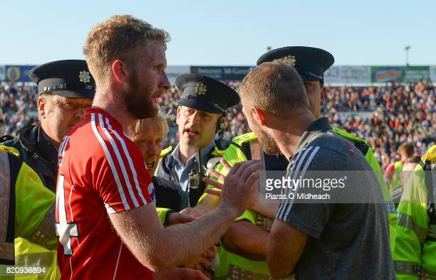 Limerick Ireland 22 July 2017 Cork selector Billy Sheehan has words with referee Ciarán Branagan after the game as he is assisted from the field by...