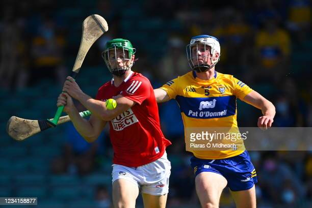 Limerick , Ireland - 23 July 2021; Séamus Harnedy of Cork is hooked by Diarmuid Ryan of Clare as he prepares to shoot for a first half goal during...