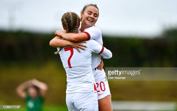 Limerick , Ireland - 23 October 2021; Agnes Beever-Jones of England celebrates with team-mate Olivia McLoughlin after scoring her side's seventh goal...