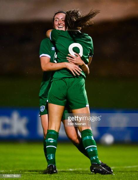 Limerick , Ireland - 23 October 2021; Emma Bucci, left, celebrates with Republic of Ireland team-mate Rebecca Watkins after scoring her side's first...