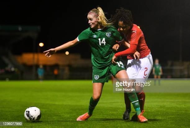 Limerick , Ireland - 23 October 2021; Erin Mc Laughlin of Republic of Ireland in action against Ella Touon of Switzerland during the UEFA Women's U19...