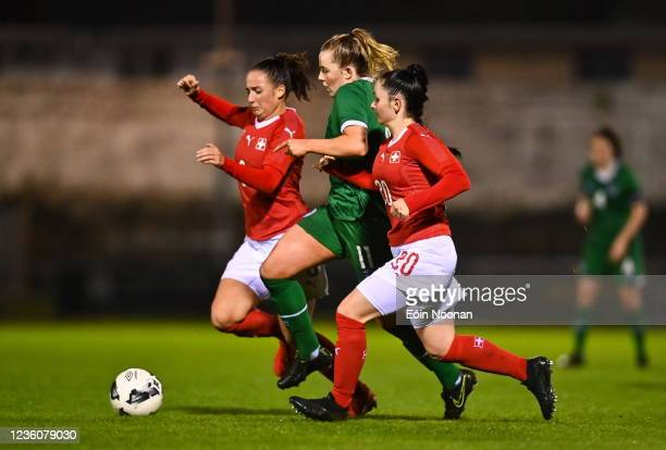 Limerick , Ireland - 23 October 2021; Kerryanne Brown of Republic of Ireland in action against Elena Mühlemann, left, and Michelle Blöchlinger of...