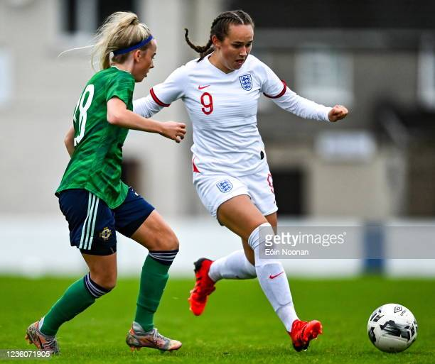 Limerick , Ireland - 23 October 2021; Lucy Watson of England in action against Ellie-Mae Dickson of Northern Ireland during the UEFA Women's U19...