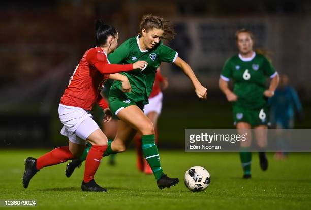 Limerick , Ireland - 23 October 2021; Rebecca Watkins of Republic of Ireland in action against Michelle Blöchlinger of Switzerland during the UEFA...