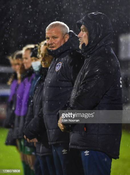 Limerick , Ireland - 23 October 2021; Republic of Ireland manager Dave Connell, with his managment team, stand for the national anthem before the...