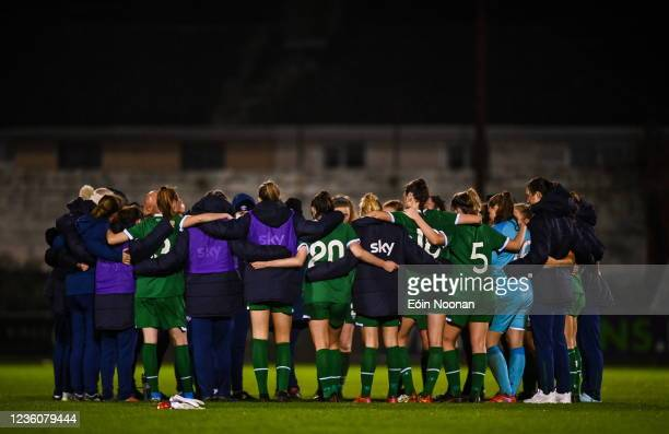 Limerick , Ireland - 23 October 2021; Republic of Ireland players and staff huddle after the UEFA Women's U19 Championship Qualifier match between...
