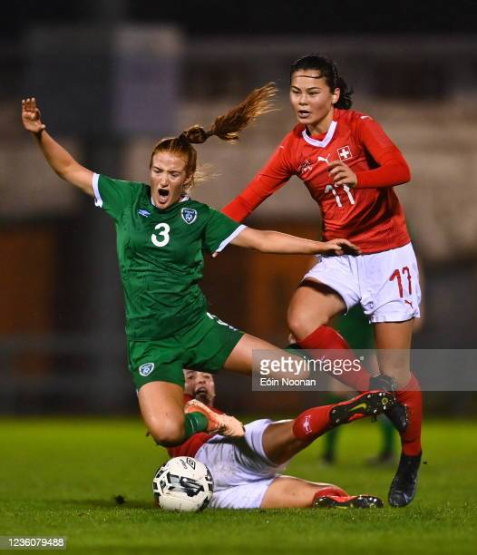 Limerick , Ireland - 23 October 2021; Shauna Brennan of Republic of Ireland in action against Sarina Heeb and Anna Matsushita of Switzerland during...