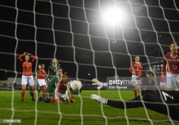 Limerick , Ireland - 23 October 2021; Switzerland goalkeeper Isabel Rutishauser saves a shot on goal from Della Doherty of Republic of Ireland late...
