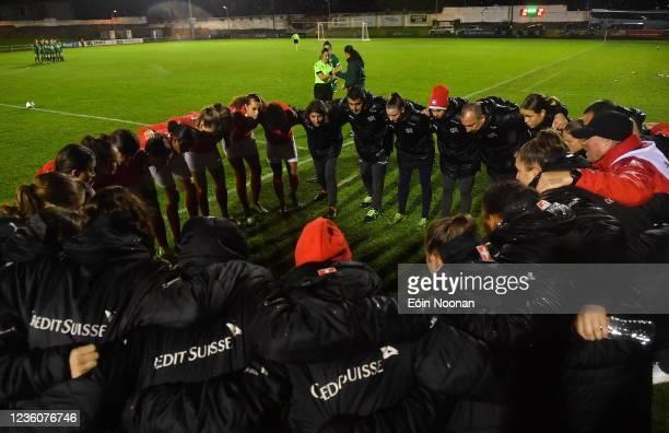 Limerick , Ireland - 23 October 2021; Switzerland players and staff huddle before the UEFA Women's U19 Championship Qualifier match between...