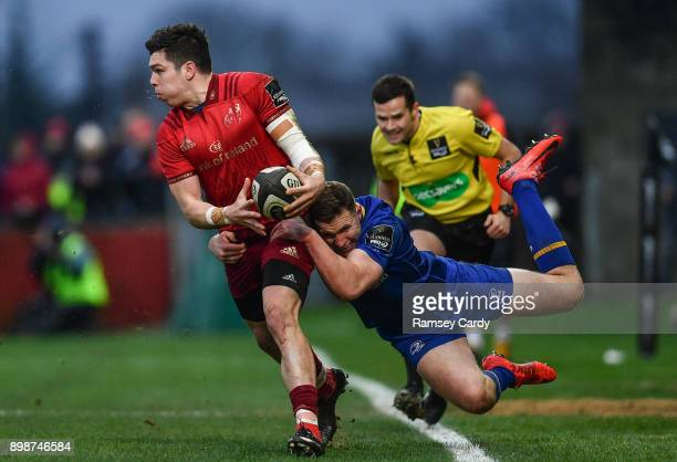 Limerick Ireland 26 December 2017 Alex Wootton of Munster is tackled by Rory O'Loughlin of Leinster during the Guinness PRO14 Round 11 match between...