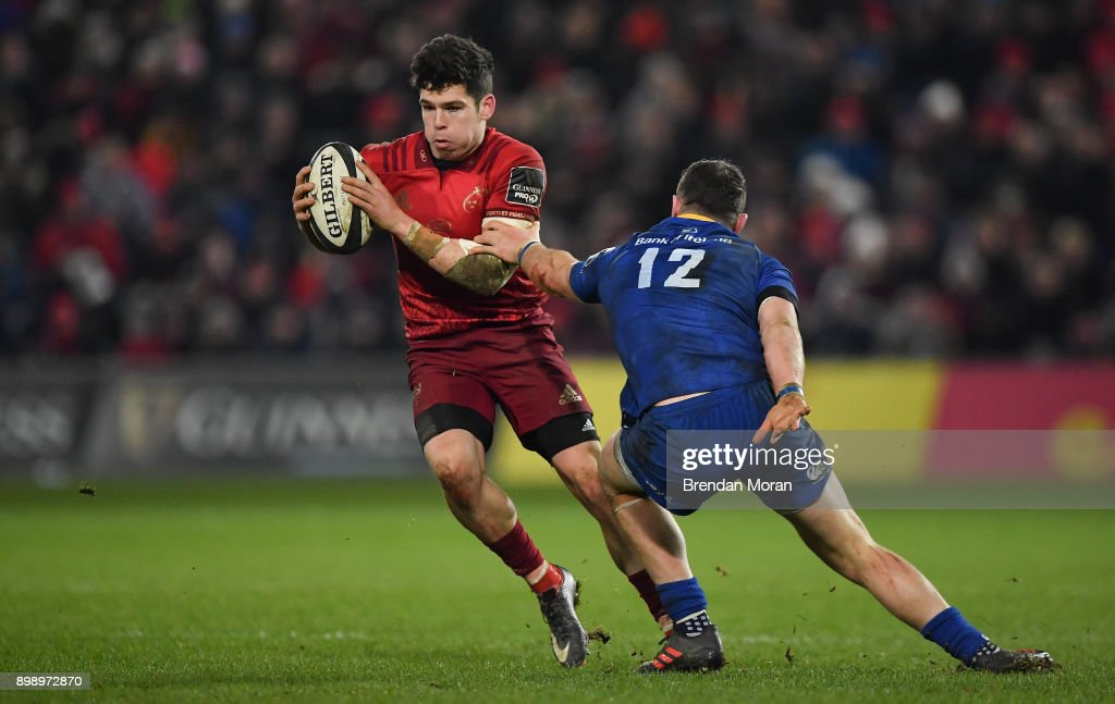 Limerick , Ireland - 26 December 2017; Alex Wootton of Munster is tackled by Robbie Henshaw of Leinster during the Guinness PRO14 Round 11 match between Munster and Leinster at Thomond Park in Limerick.