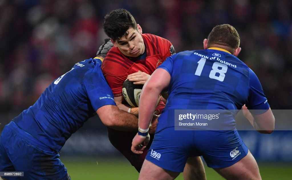 Limerick , Ireland - 26 December 2017; Alex Wootton of Munster is tackled by Mick Kearney, left, and Tadhg Furlong of Leinster during the Guinness PRO14 Round 11 match between Munster and Leinster at Thomond Park in Limerick.