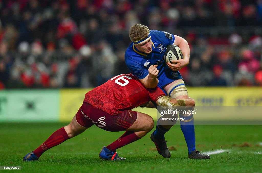 Limerick , Ireland - 26 December 2017; Dan Leavy of Leinster is tackled by Niall Scannell of Munster during the Guinness PRO14 Round 11 match between Munster and Leinster at Thomond Park in Limerick.