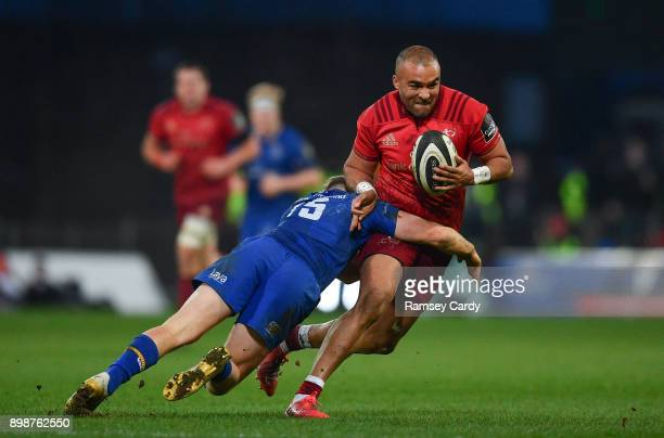 Limerick Ireland 26 December 2017 Simon Zebo of Munster is tackled by Jordan Larmour of Leinster during the Guinness PRO14 Round 11 match between...
