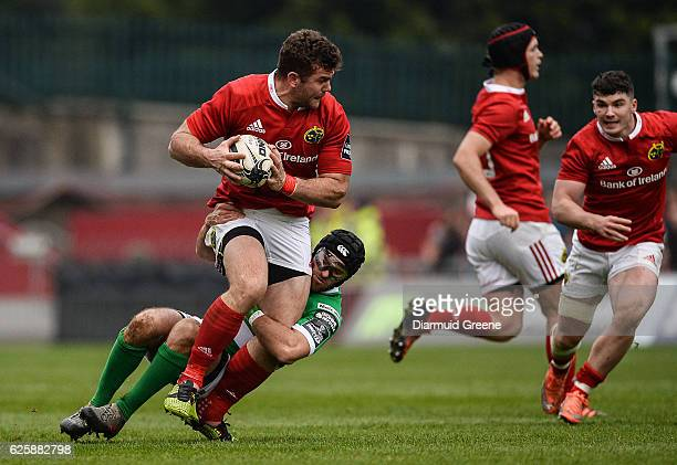 Limerick Ireland 26 November 2016 Jaco Taute of Munster is tackled by Ian McKinley of Benetton Treviso during the Guinness PRO12 Round 9 match...