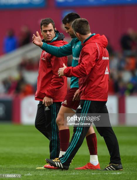 Limerick Ireland 27 April 2019 Conor Murray of Munster leaves the field with Munster head coach Johann van Graan left and Munster lead...