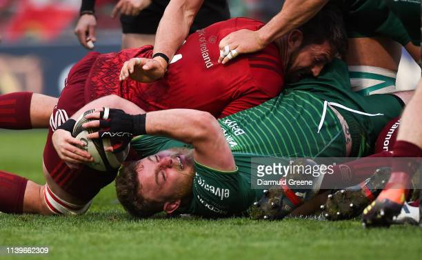 Limerick , Ireland - 27 April 2019; Finlay Bealham of Connacht scores his side's first try despite the efforts of Jean Kleyn of Munster during the...