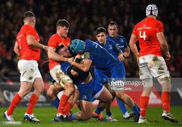 Limerick , Ireland - 28 December 2019; Andrew Porter supported by Will Connors in action against Jack O'Donoghue of Munster during the Guinness PRO14...