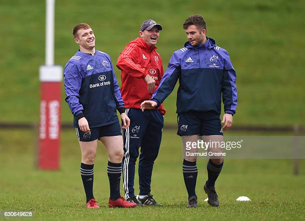 Limerick Ireland 29 December 2016 Munster defence coach Jacques Nienaber Rory Scannell and Jaco Taute share a laugh during squad training at the...