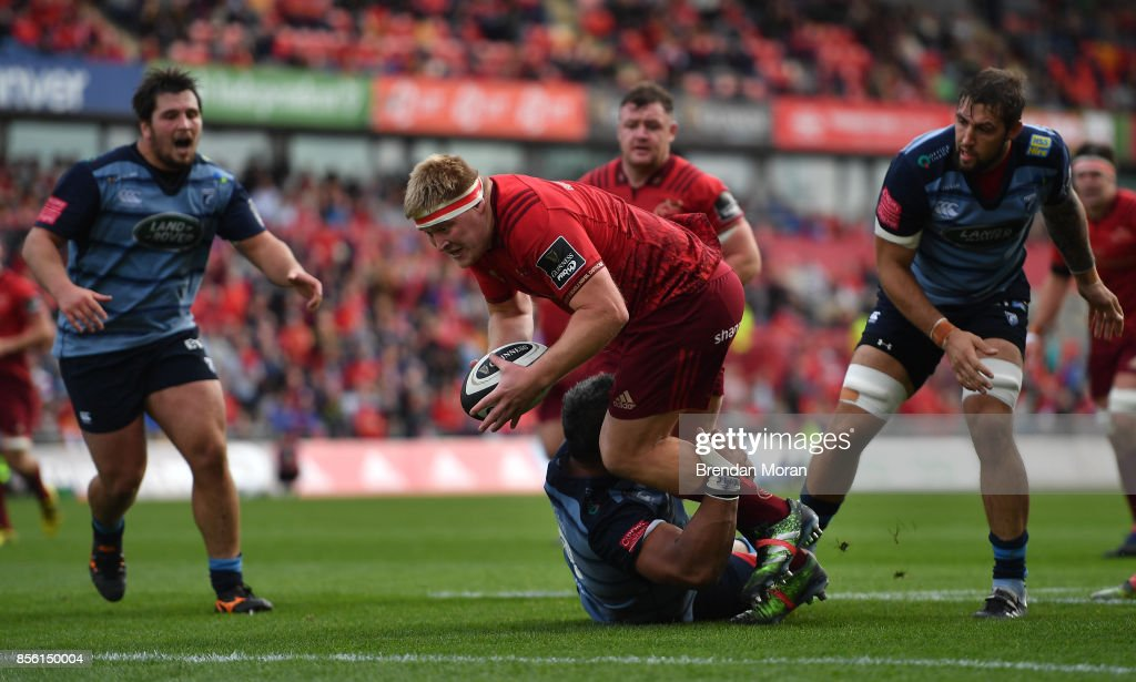 Limerick , Ireland - 30 September 2017; John Ryan of Munster is tackled by Nick Williams on the way to scoring his side's second during the Guinness PRO14 Round 5 match between Munster and Cardiff Blues at Thomond Park in Limerick.