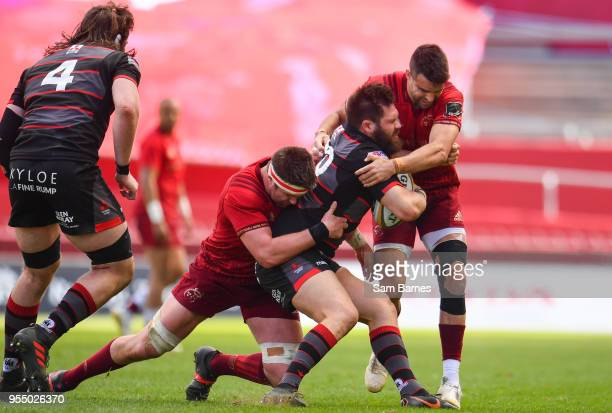 Limerick Ireland 5 May 2018 Cornell Du Preez of Edinburgh is tackled by Billy Holland and Conor Murray of Munster during the Guinness PRO14 semifinal...