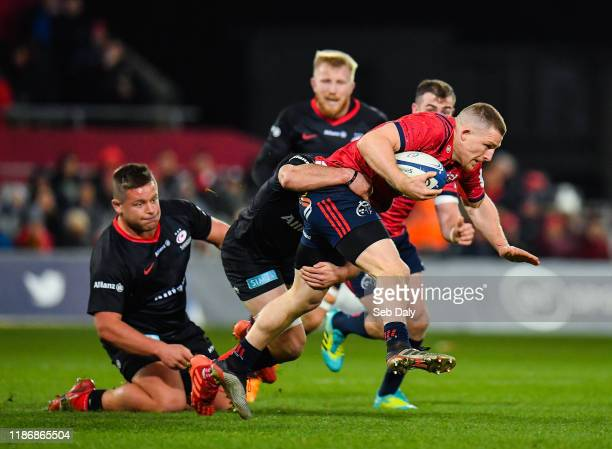 Limerick Ireland 7 December 2019 Andrew Conway of Munster is tackled by Ben Earl of Saracens during the Heineken Champions Cup Pool 4 Round 3 match...