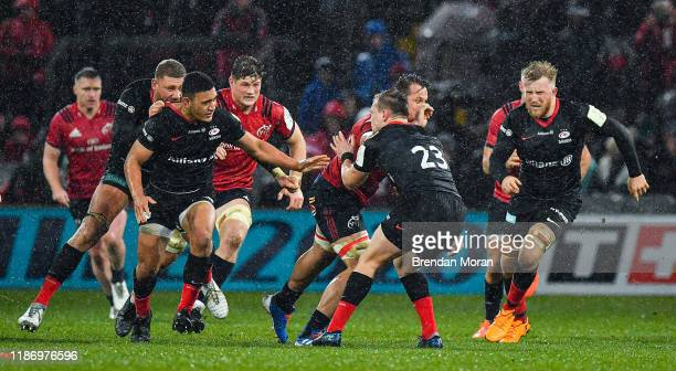 Limerick , Ireland - 7 December 2019; Arno Botha of Munster tackles Nick Tompkins of Saracens with his arm raised resulting in him being shown a red...