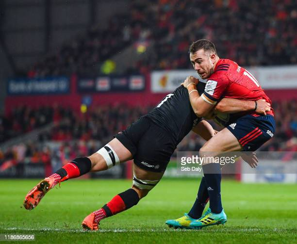 Limerick Ireland 7 December 2019 JJ Hanrahan of Munster is tackled by Ben Earl of Saracens during the Heineken Champions Cup Pool 4 Round 3 match...
