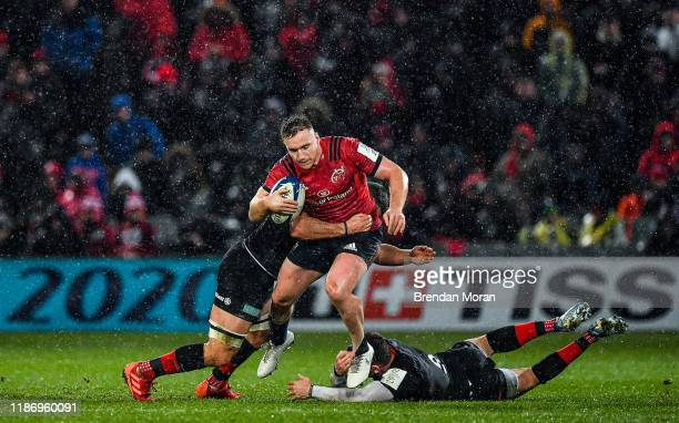 Limerick Ireland 7 December 2019 Rory Scannell of Munster is tackled by Ben Earl and Ben Spencer of Saracens during the Heineken Champions Cup Pool 4...
